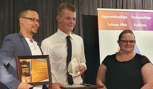 TAFE SA student Robbie Correll (centre) receives his award for Apprentice of the Year.