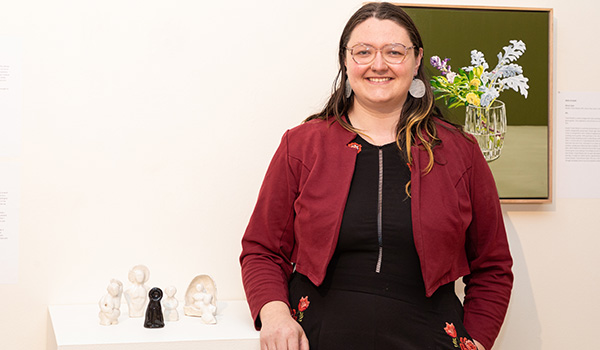 """TAFE SA visual arts student Tina McKenzie with her work """"Replacement Mother Figures"""". Photo Andrew Beveridge"""